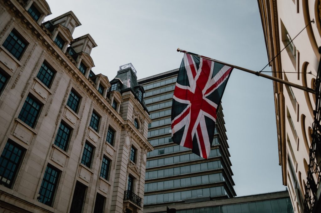 United Kingdom flag flies under London sky